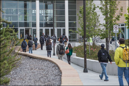 Students walk toward the entrance to City College of San Francisco
